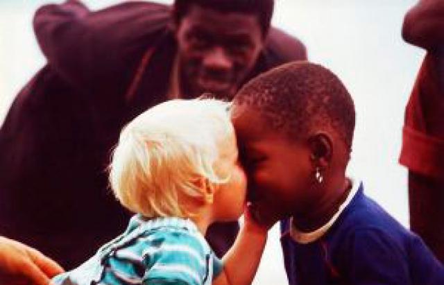 Black girl kiss white girl